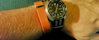 Orange FitBit Flex on arm with Seiko Automatic Diver