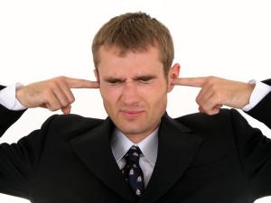 bigstock-Businessman-Putting-Fingers-In-210925