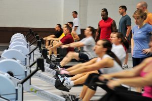 U.S. Air Force Master Sgt. Bradford Godwin, Air Force Weather Agency, uses the concepts two rower with other Team Offutt members during the tactical fitness class in the field house on Offutt Air Force Base, Neb., April 2. (U.S. Air Force photo by Charles Haymond/Released)